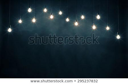 Lâmpadas azul parede vidro preto Foto stock © Yatsenko