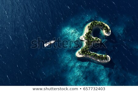 Tropical island in the form of the British pound symbol Stock photo © maxmitzu