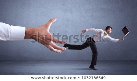 Businessman running on the big hand. Stock photo © Neokryuger
