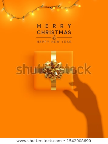 Woman holding glowing christmas garland in hands Stock photo © tekso