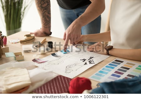 Female fashion designer working on sketches with paint Stock photo © deandrobot