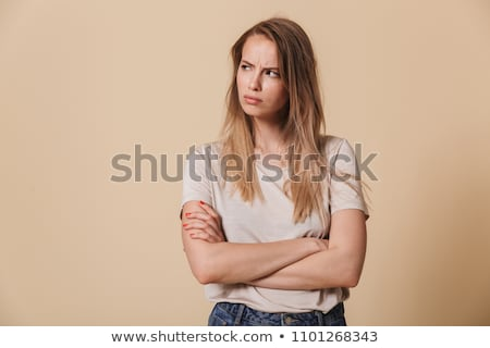 Portrait of an angry disappointed girl standing Stock photo © deandrobot