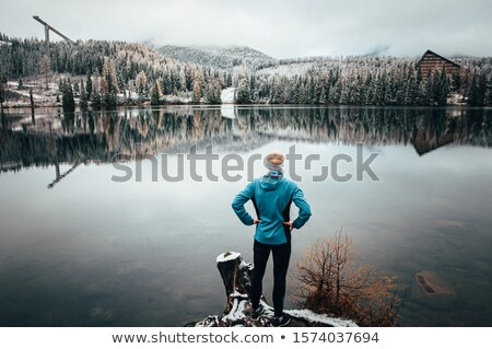 Man and woman stare out at a lake Stock photo © IS2