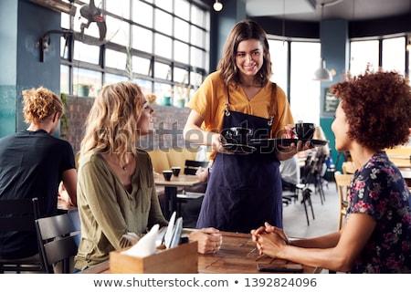 улыбаясь официантка красивой молодые рабочих торты Сток-фото © LightFieldStudios