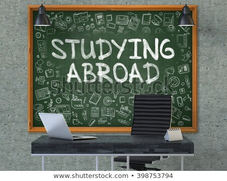 Hand Drawn Studying Abroad on Office Chalkboard. Stock photo © tashatuvango