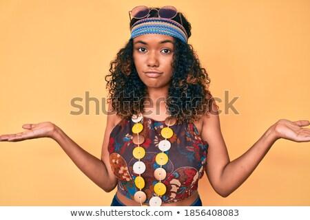 Young african hippie woman shrugging shoulders. Stock photo © RAStudio