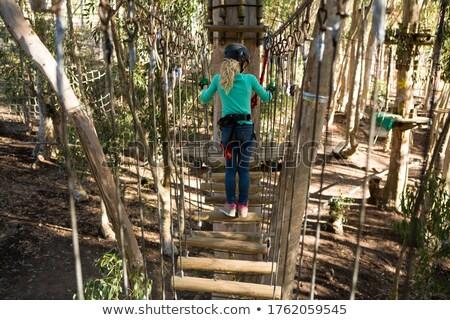 小女孩 頭盔 木 橋 森林 商業照片 © wavebreak_media