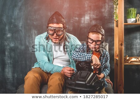 Stock photo: Smiling father having fun with his little daughter