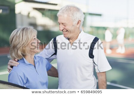 Older couple hugging on tennis court Stock photo © IS2