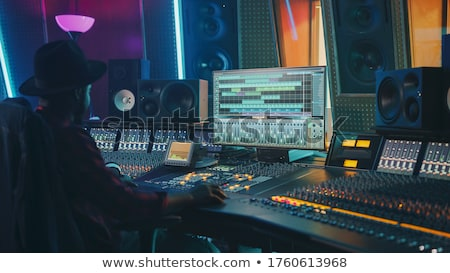 man at mixing console in music recording studio stock photo © dolgachov