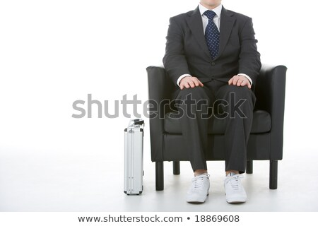 Businessman Sitting Wearing Sneakers stock photo © monkey_business