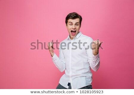 Man permanente geïsoleerd winnaar gebaar Stockfoto © deandrobot
