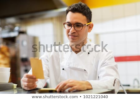 chef at kebab shop with order or paper note Stock photo © dolgachov