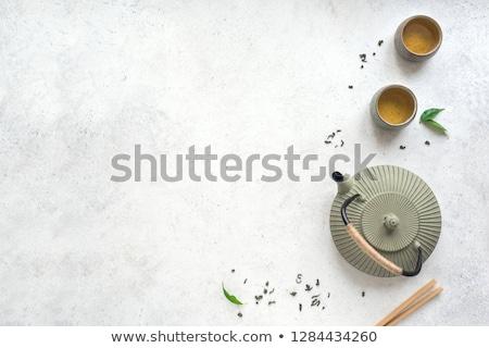 Asian green tea set on bamboo mat Stock photo © dash