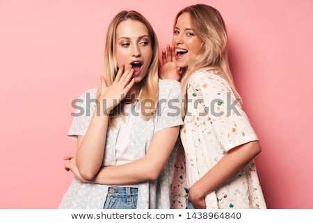Two pretty shocked young girls friends standing Stock photo © deandrobot