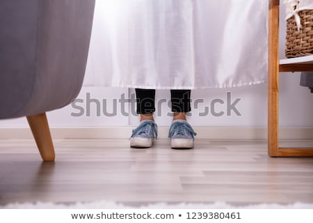 Girl's Feet Behind The Curtain Stock photo © AndreyPopov