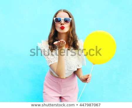 Portrait of a cheerful young girl with bright makeup Stock photo © deandrobot