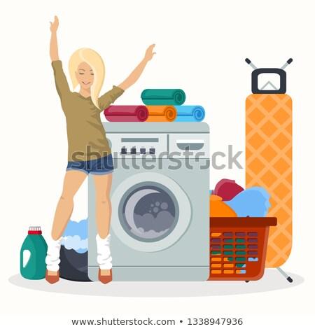 Mutlu kadın çamaşırhane çalışma çamaşır makinesi Stok fotoğraf © makyzz