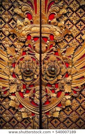 Red door decorated with golden door knobs Stock photo © bbbar
