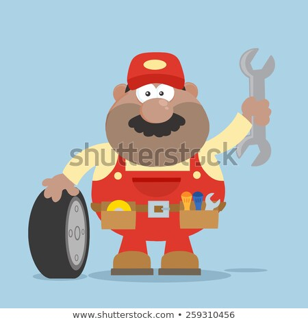 Smiling African American Mechanic Cartoon Character With Tire And Huge Wrench Flat Syle Stock photo © hittoon