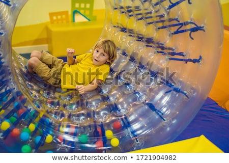 Cute weinig jongen spelen plastic cilinder Stockfoto © galitskaya