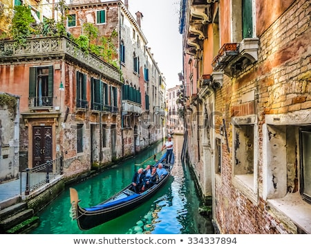 narrow channel between colorful historic houses in venice italy stock photo © boggy