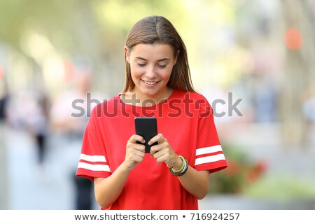 Happy student writing text message stock photo © nyul