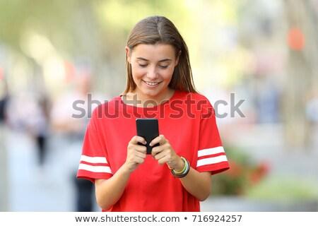 Stockfoto: Gelukkig · student · schrijven · tekst · mobiele · telefoon