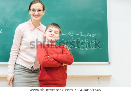 Brilliant schoolboy is proud of his work and so is the teacher Stock photo © Kzenon