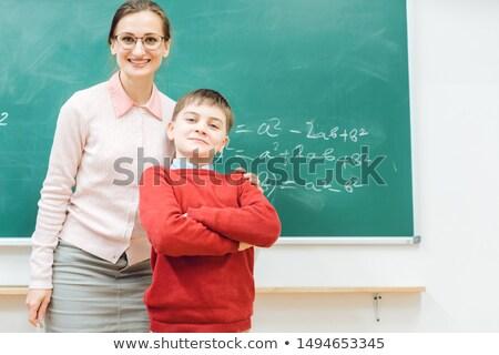 Błyskotliwy uczeń dumny pracy nauczyciel zarówno Zdjęcia stock © Kzenon