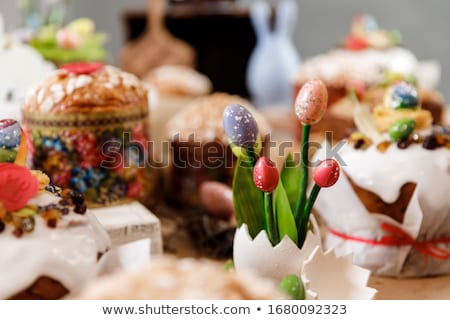 cupcake with chocolate eggs and candies on table Stock photo © dolgachov