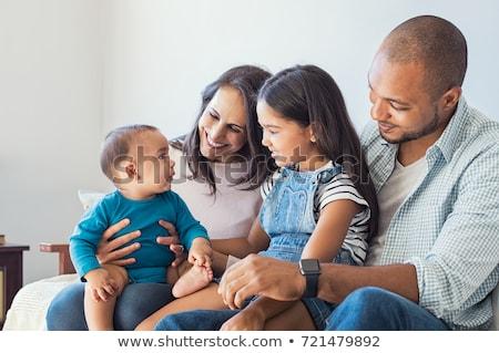 happy mixed-race family with baby son at home Stock photo © dolgachov