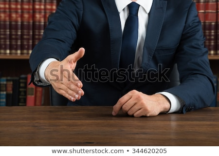 Lawyer Offering Handshake At Desk In Courtroom Stock photo © AndreyPopov