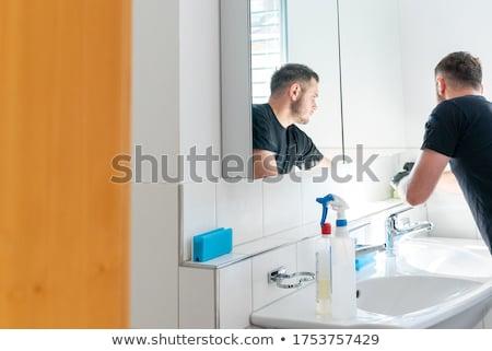 Mann Reinigung tippen junger Mann Stahl Küche Stock foto © AndreyPopov