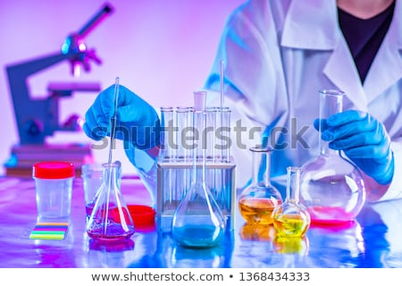 Chemist working in the lab on new experiment Stock photo © Elnur