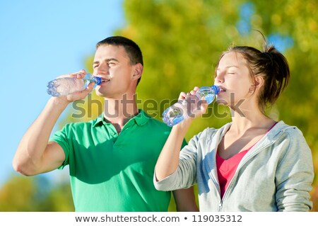 Nő ivóvíz sport testmozgás park áll Stock fotó © Kzenon