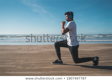 Push-up fitness man training pushups on beach doing bodyweight exercises for arms workout. Healthy l Stock photo © Maridav