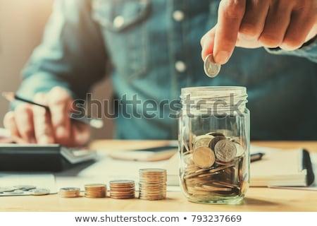 Para dolar kumbara iş yüz Stok fotoğraf © photocreo