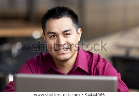 Hispanic Businessman - Telecommuting from Internet Cafe Stock photo © dgilder