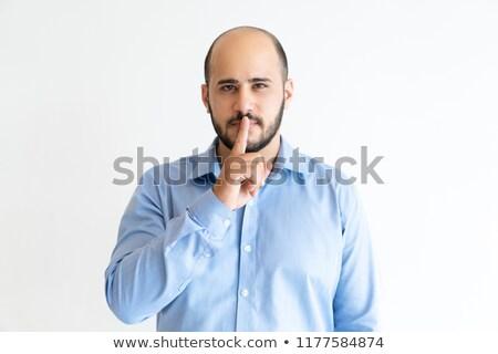 Bald businessman making shush gesture Stock photo © photography33