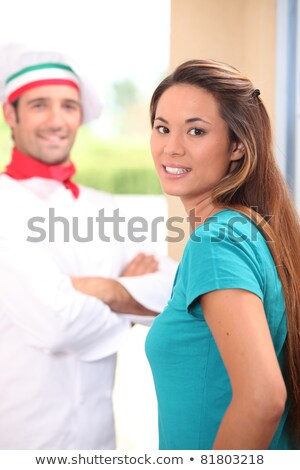 Pizza chef stood at customers door Stock photo © photography33