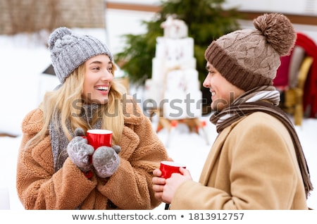 Stock photo: Couple having a mug of hot chocolate in the forest