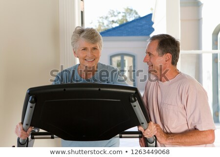 Middle-aged man on treadmill at home Stock photo © photography33