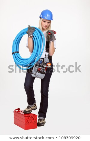 Female plumber in red with a red pipe and wrench Stock photo © photography33