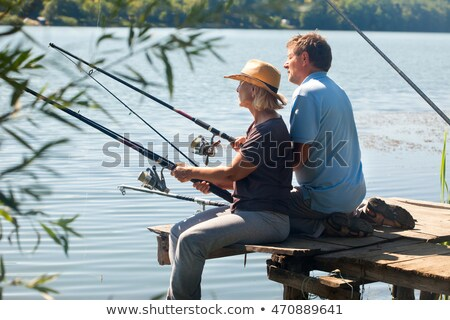 Couple fishing on a pontoon Stock photo © photography33
