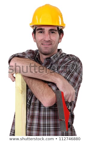 Tradesman holding a wooden plank and a plane Stock photo © photography33