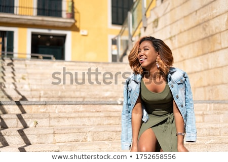 Cute young woman posing in modern green dress Stock photo © gromovataya