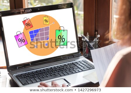 sale on screen showing special discounts stock photo © stuartmiles