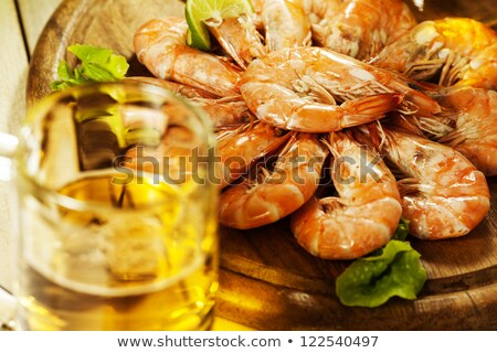 Shrimps and a glass of beer. Shallow depth of field. Stock photo © moses