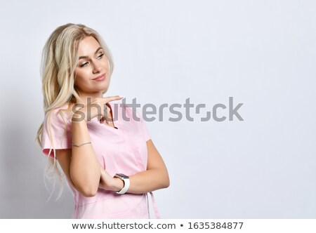 beautiful business girl in a pink suit poingint out something stock photo © len44ik